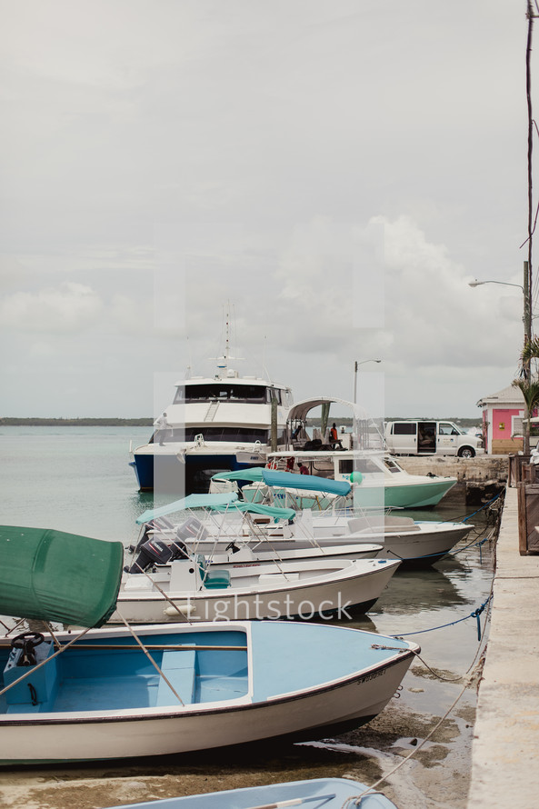 boats tied to a dock in the Bahamas