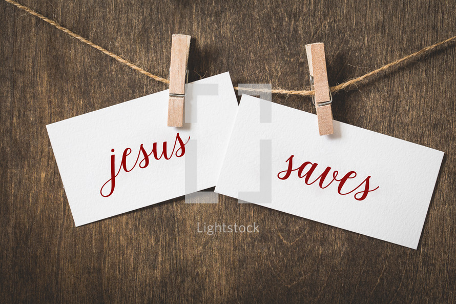 words Jesus saves on white card stock hanging from a clothespin on a clothesline