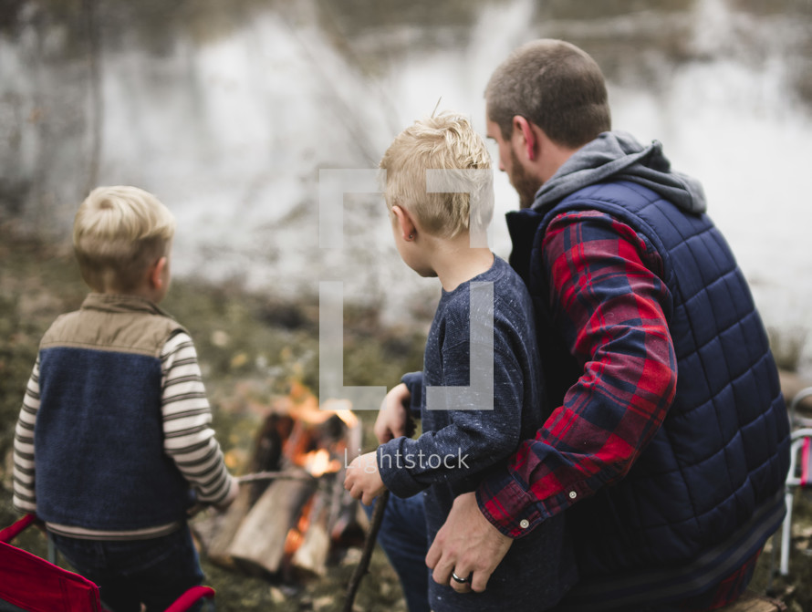 father and son's around a fire