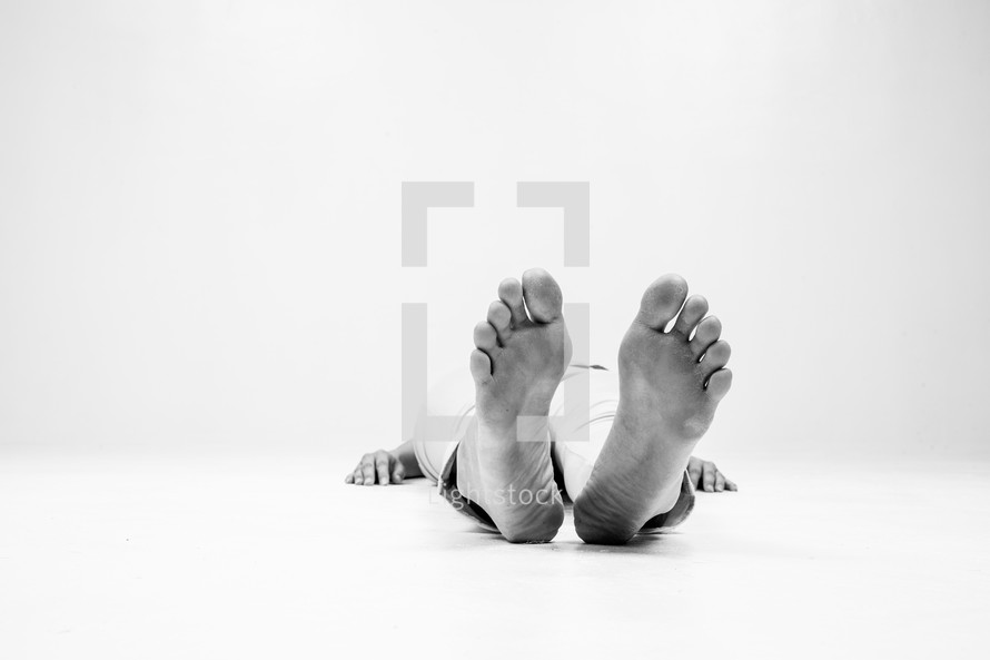 a woman lying on the floor with feet facing forward