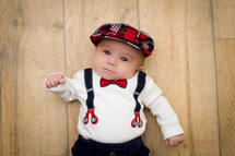 infant boy in suspenders