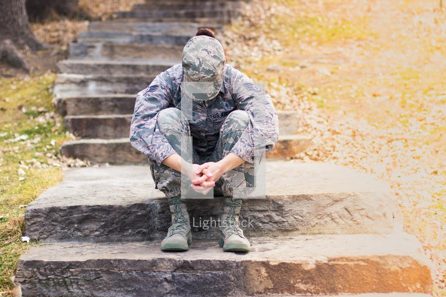 female soldier praying