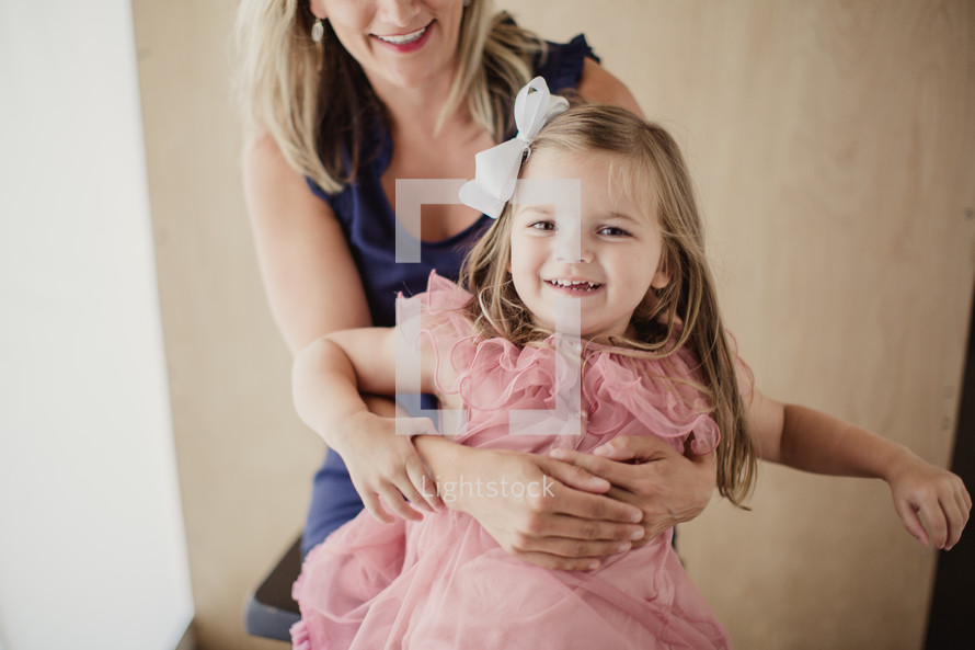 mother and daughter on a stool