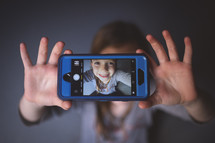 kid's selfie on a cellphone screen