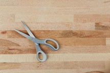 scissors on a wood cutting board