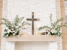 cross and flowers on an altar