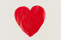 painted red heart on white paper