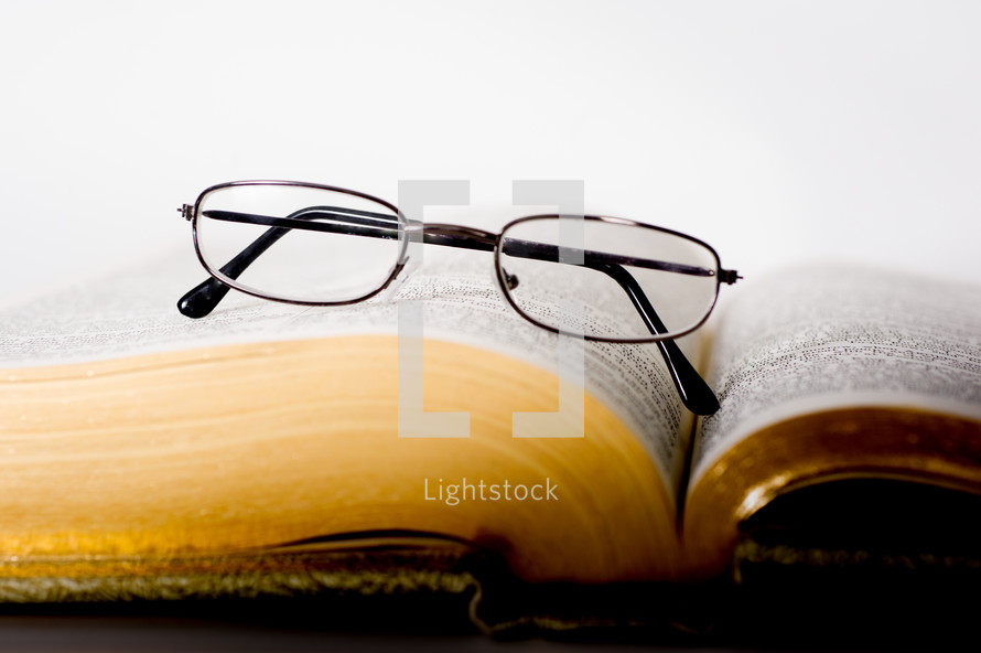Glasses on an open bible.