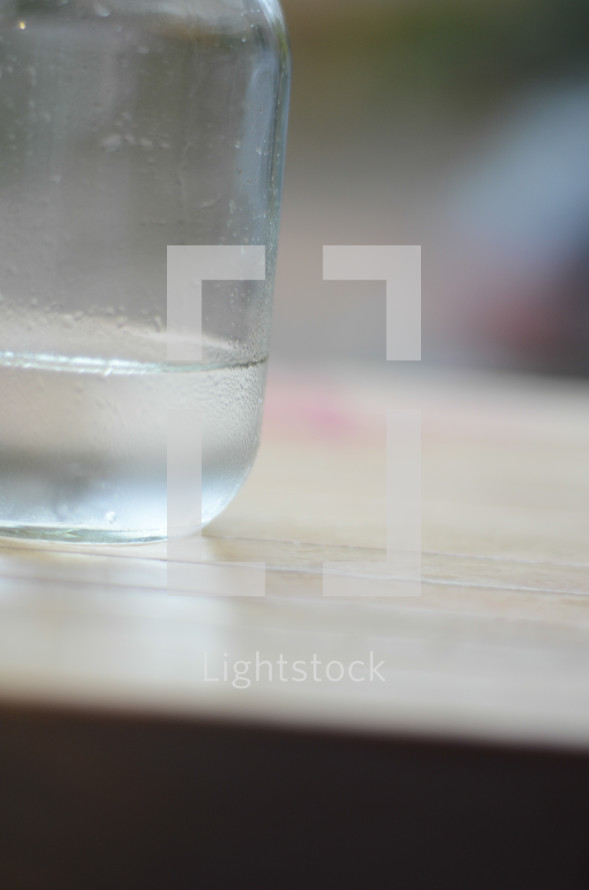 water in a mason jar on a counter