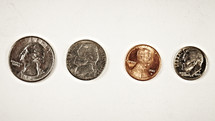 A quarter, nickel, penny and dime isolated on white