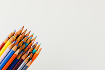 sharpened colored pencils on a white background