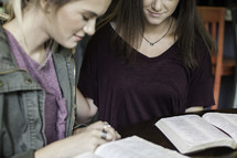 girls in prayer at a Bible study