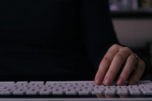 persons hand on computer keyboard