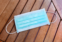 surgical mask on a wood background