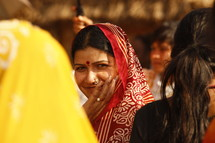 woman with Bindi touching her face