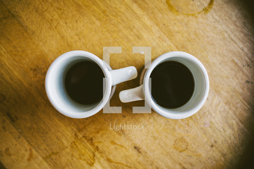 Two mugs of coffee on a table