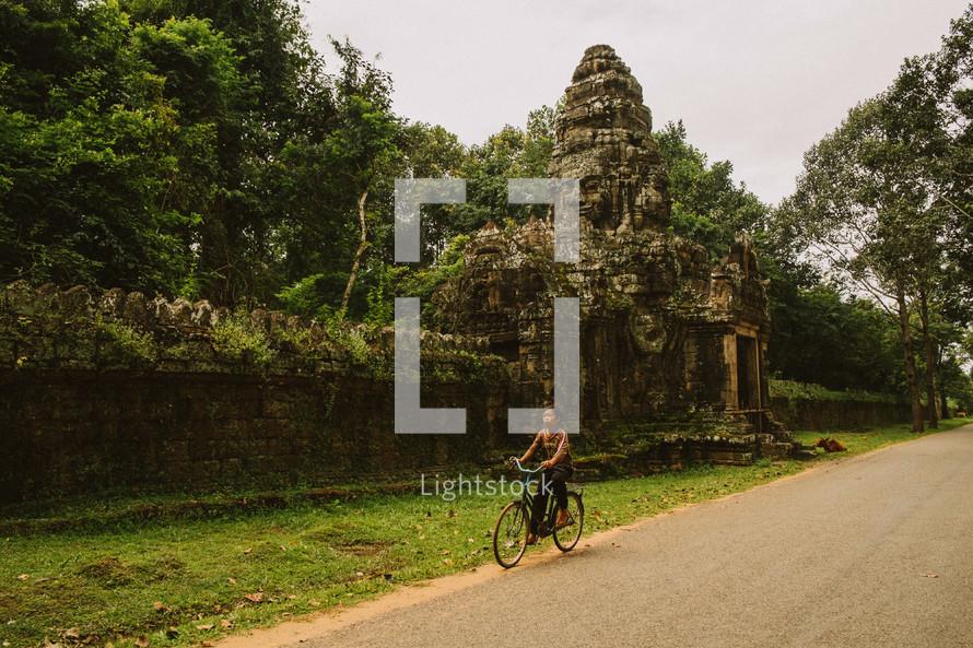 Child riding a bike in Cambodia