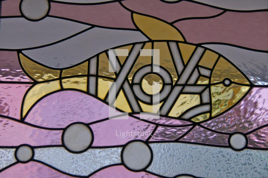 Stained Glass Window. Christian Fish,  IXOYE, Greek.