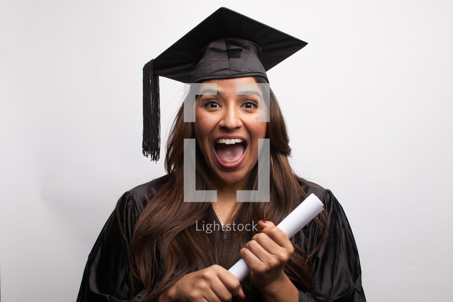 smiling graduate holding a diploma