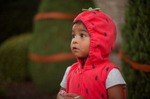a child in a strawberry Halloween costume