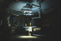 Dimly lit operating room.