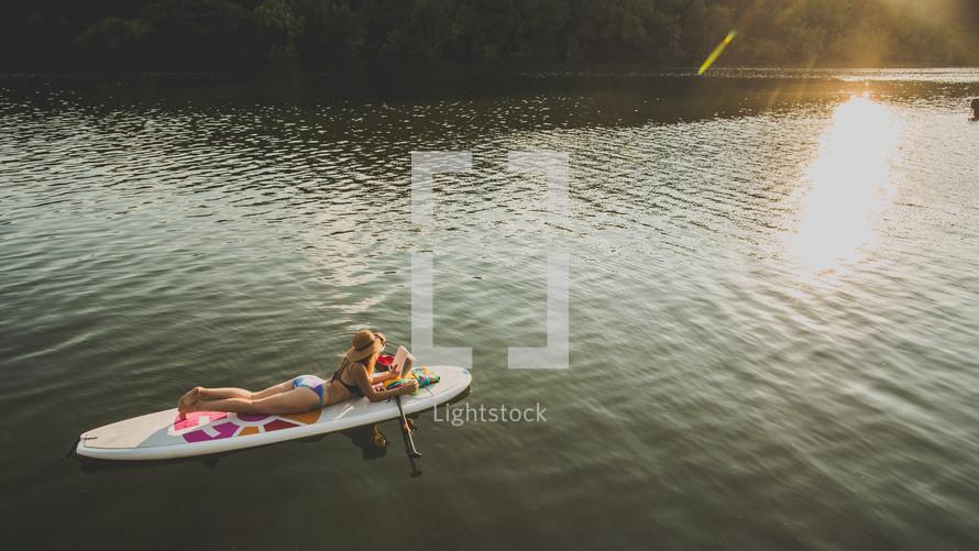 woman in a bikini on a paddle board