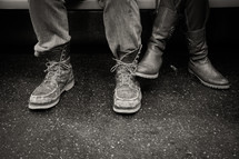 feet of a man and woman in boots