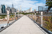 wood walkway and city view