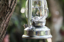 a lantern hanging on a tree