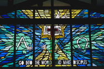 stained glass window and words GO INTO THE WORLD AND MAKE DISCIPLES