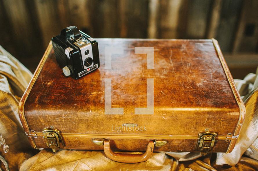 antique box camera and suitcase