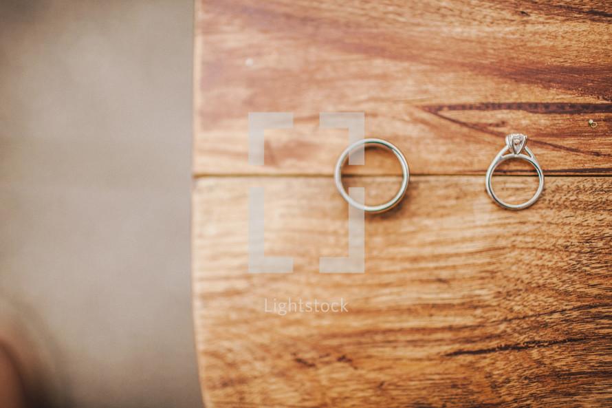 Wedding rings on wood table