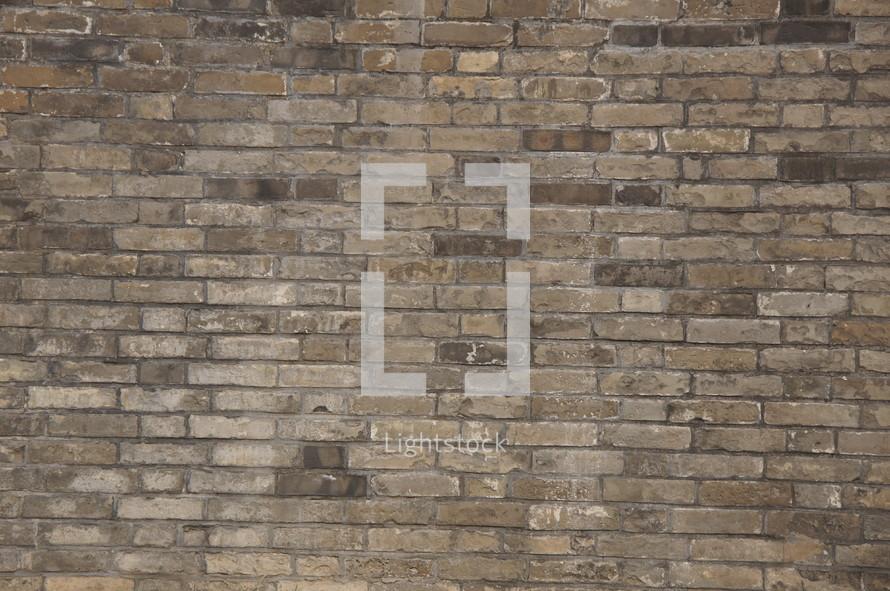 Ancient, hand made clay brick wall