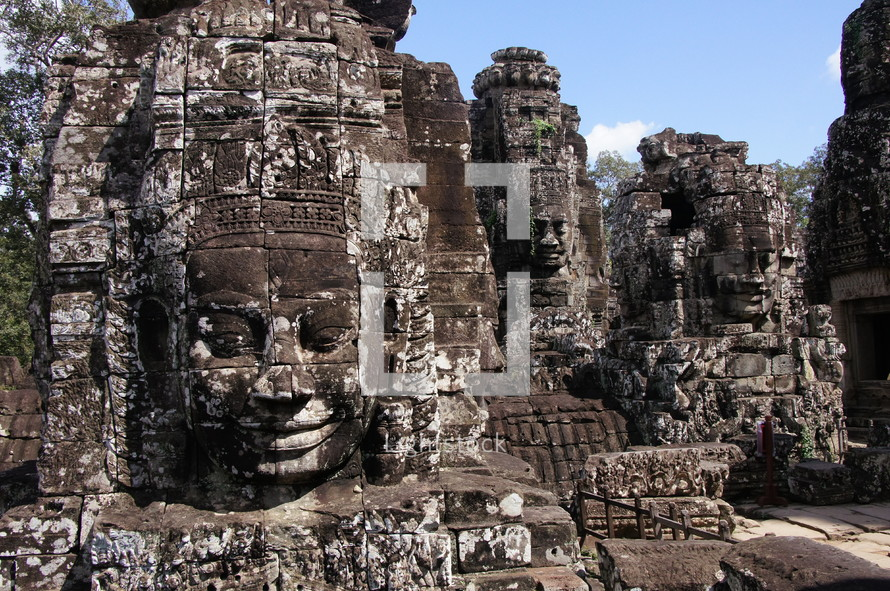buddhist sculptures in towers of Bayon temple