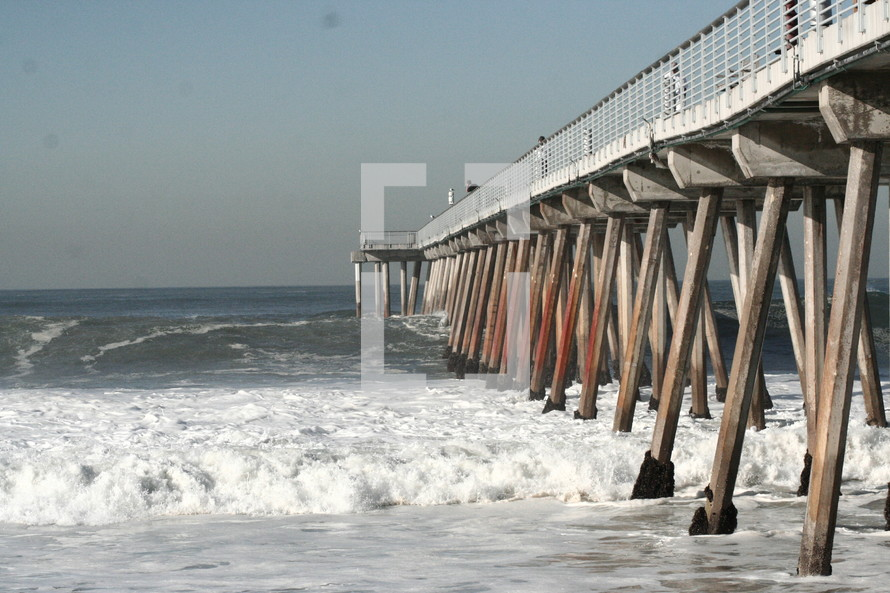 Beach boardwalk over water