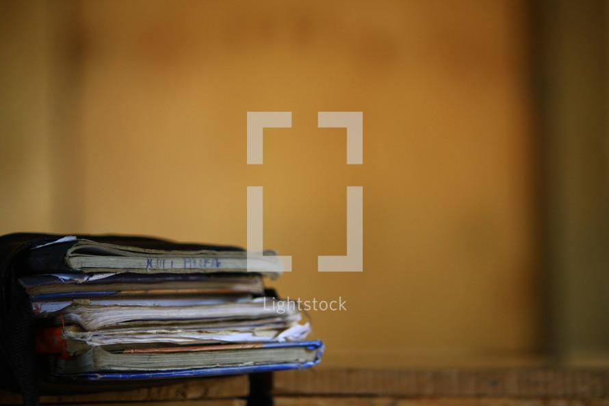 Worn books on a desk.
