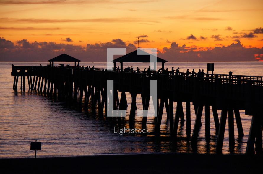 Atlantic Ocean sunrise over fishermen's pier.