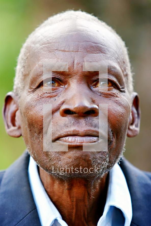 African Elderly man smiling missions Uganda