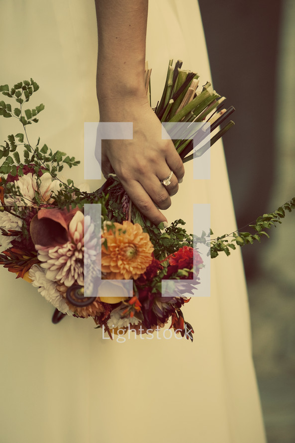 A bride holds her bouquet