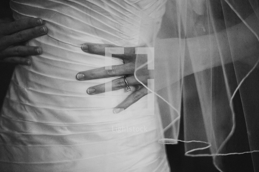 torso of a bride with her hands on her waist