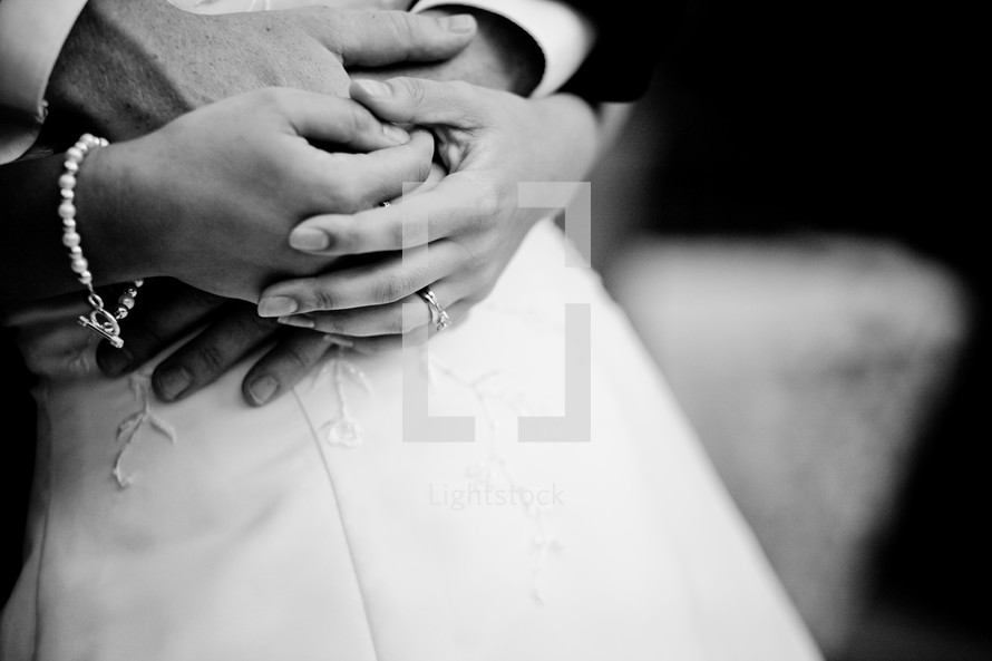brides hands over grooms hands