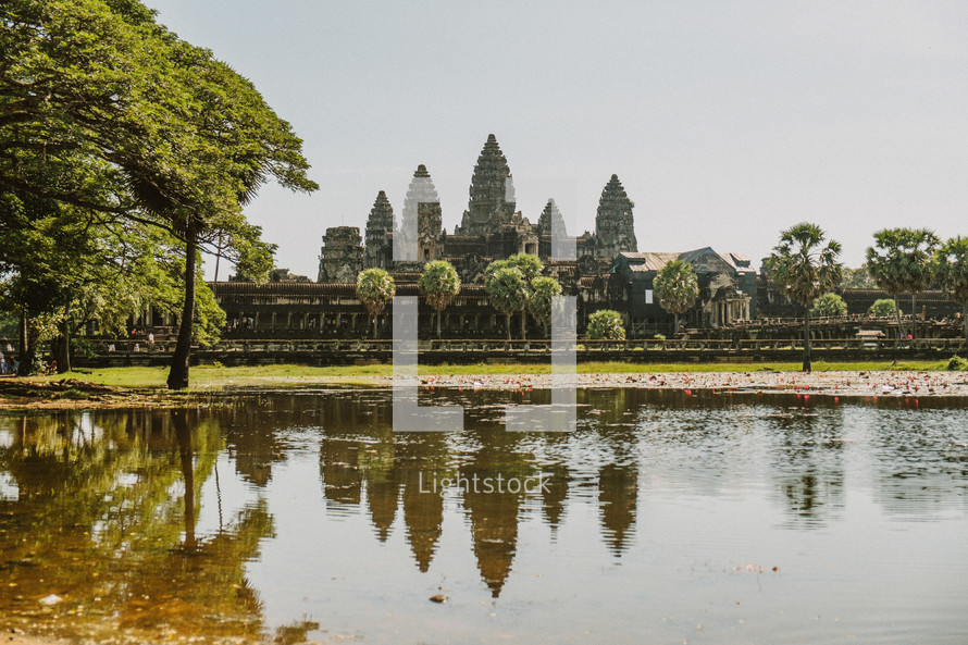 temple ruins across a river in Thailand