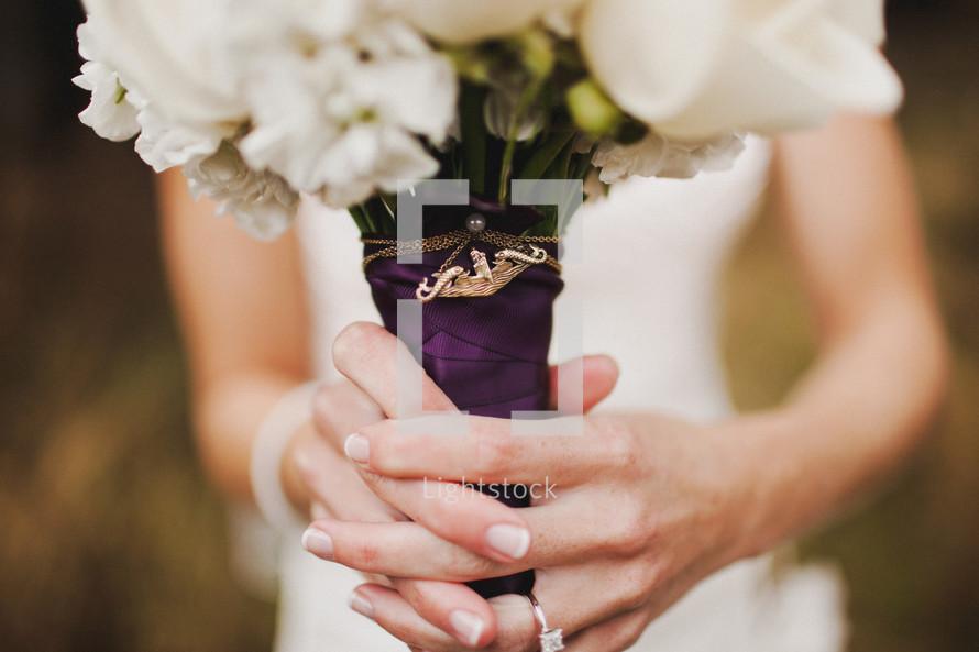 brides hands holding a bouquet