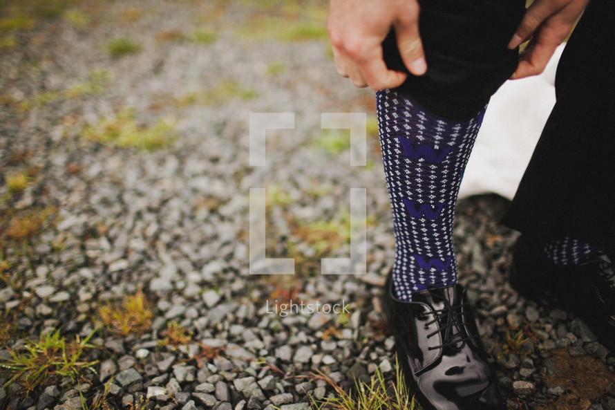 Man wearing purple socks