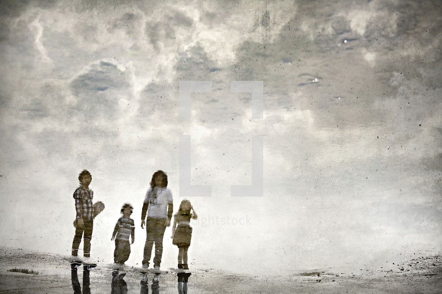 A reflection of four children