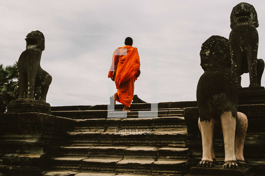 Buddhist monk walking up stairs