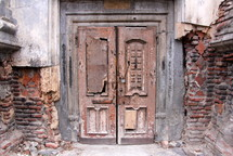Wooden church doors padlocked and silent after years of persecution and neglect