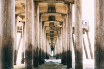 Underneath a pier at the beach