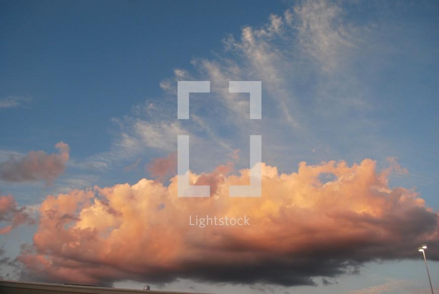pink cloud in a blue sky