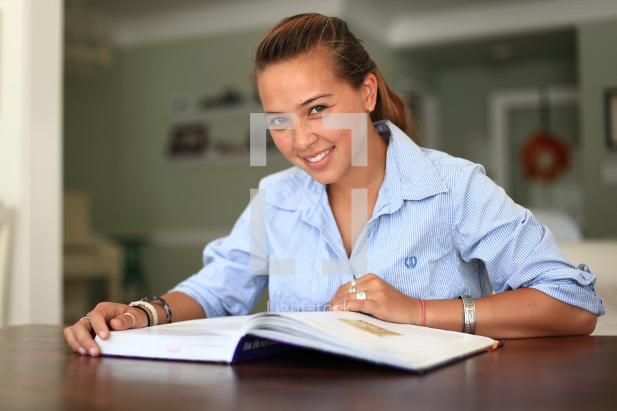 Smiling female with an open book